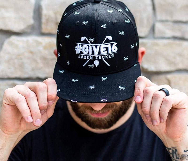 Jason Zucker modeling Give16 hat